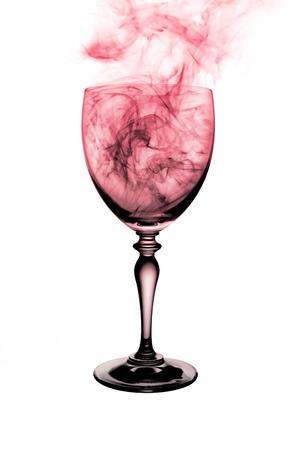 cognac: brandy cognac glass with colorful  smoke