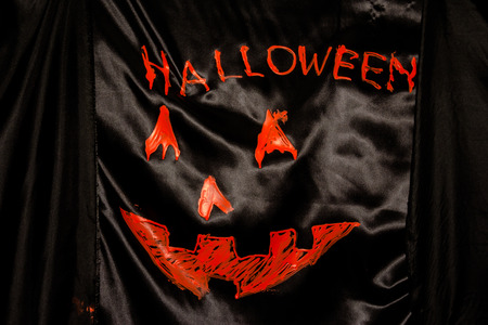 and spelling: orange word spelling Halloween on black cloth