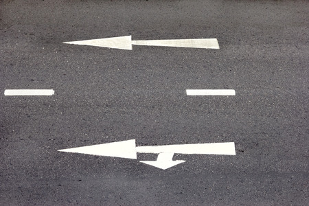 high angle: high angle of the road with white arrow. Stock Photo
