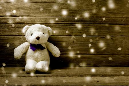 bear doll: snow teddy bear on wood background Stock Photo