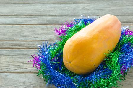 the tinsel: Ripe papaya with tinsel