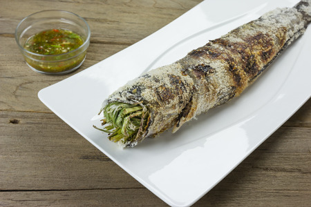 snakehead: grill striped snakehead fish with salt coated