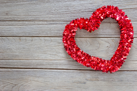 the tinsel: Tinsel heart  decoration on wood background Stock Photo