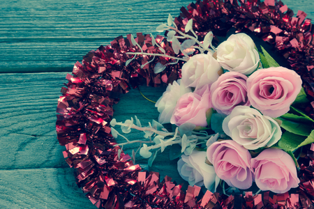 the tinsel: Rose with Tinsel heart  decoration,filter effect. Stock Photo