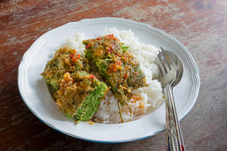 cha om: Cha-OM-plated egg with shrimp paste chili sauce, Thai Cuisine Stock Photo