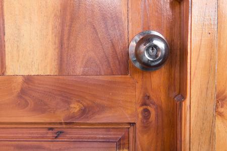 door knob: steel door knob on the wooden door Stock Photo