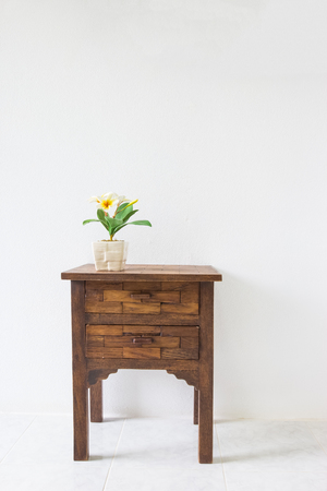 antique table: brown wood table in white room. Stock Photo
