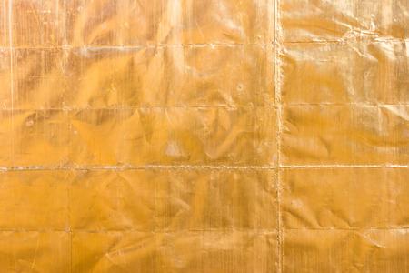 luminance: Metal surface is golden. Stock Photo