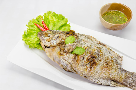 oreochromis niloticus: fish grilled with salt on background,Thai food Stock Photo