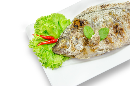 niloticus: fish grilled with salt on background,clipping path Stock Photo