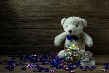 Teddy bear on wood background, still life