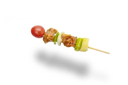 skewer of mixed meat and vegetables isolated on white background