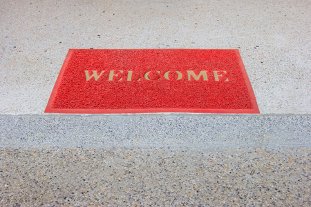 red welcome carpet on staircase