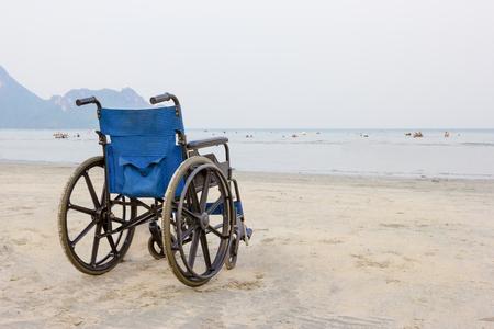wheelchair on the beach in summer