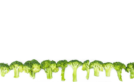 collocation: raw broccoli on white background
