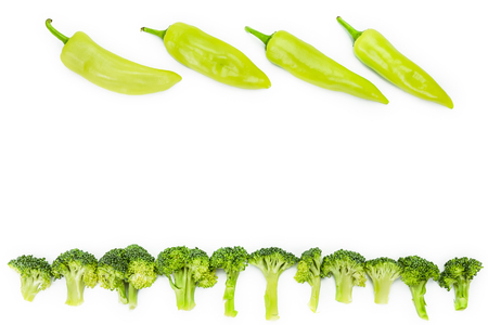 collocation: raw broccoli with green pepper on white background Stock Photo