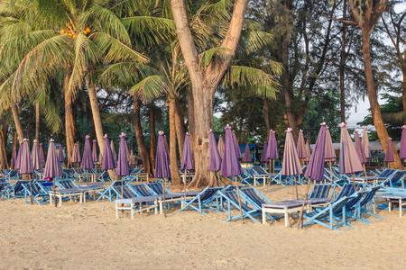 sun umbrellas: Beach chairs with closed sun umbrellas