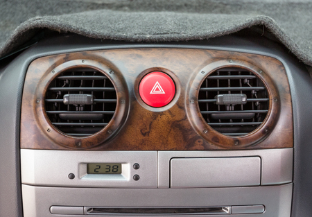 vents: emergency button in car with air vents Stock Photo