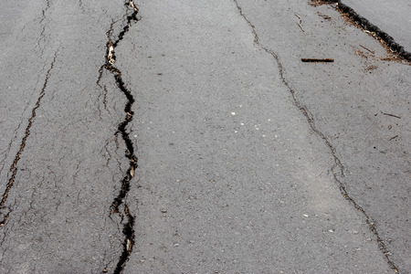 collapsed: Road collapsed and subsidence cracking.