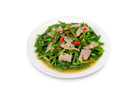 alliaceae: stir-fried pork and garlic chive isolated on white background,clipping path