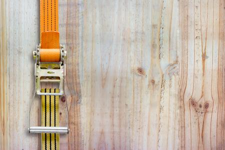 duty belt: ratchet strap on wood background Stock Photo
