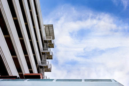 fire escape with blue sky and cloud Stock Photo