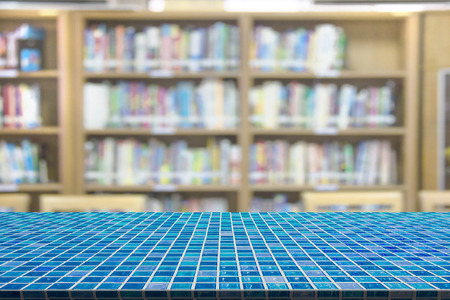 mosaic table with with library blur background Stock Photo