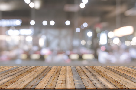 shiny floor: Wooden table with blur restaurant background Stock Photo