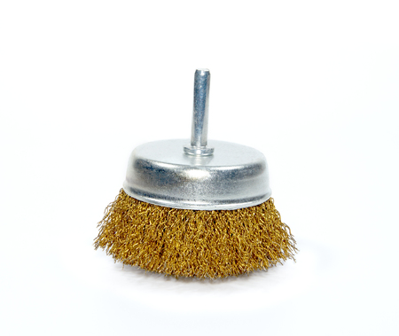 Wire brush for cleaning on white background.