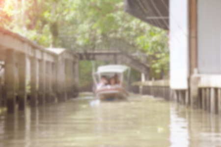 diminishing perspective: Canal in countryside wiht boat blur background of Illustration,Abstract Blurred