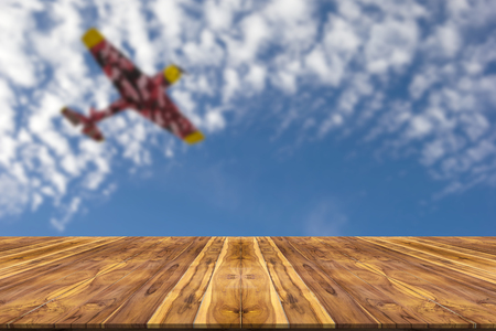 wood panel: Wooden table with blur sky and plane background