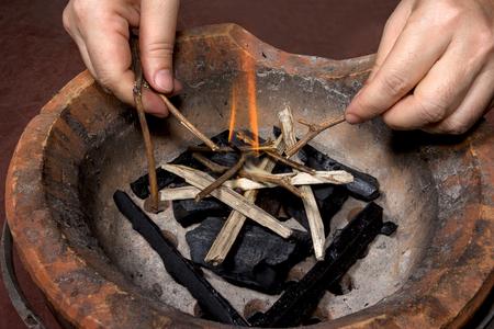 ignite:  Ignite on stove with hand Stock Photo