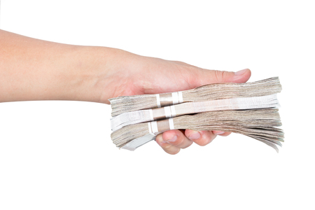 Hands holding banknotes on white background Foto de archivo