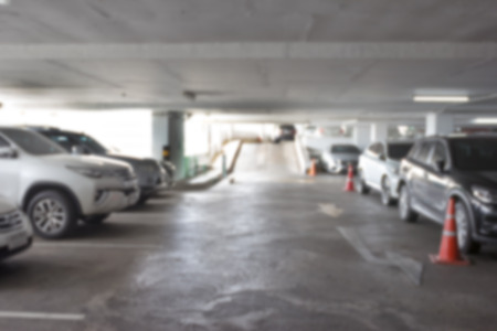 urban area: Car parking lot interior blur background ,Abstract Blurred