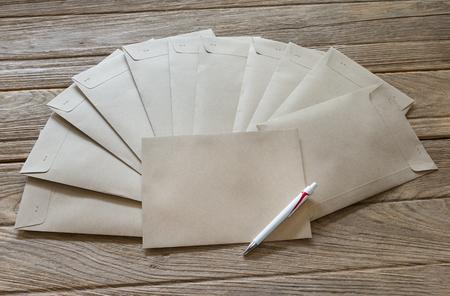envelop: Brown Letter Envelop with pen on wooden table