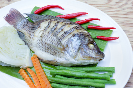 white nile: Steamed Nilotica fish,thai style steamed fish with vegetable