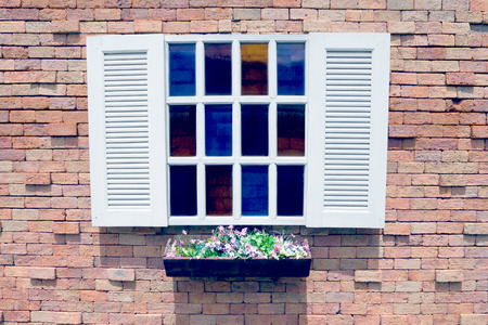 antique vase: White wooden window and Flower pot on brick wall background,filter effect