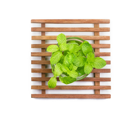 Mint in the transparent glass bowl isolated on white background