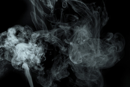 Abstract  powder or smoke isolated on black background