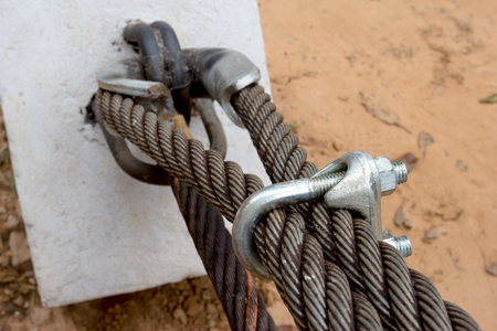 closeup locked cable pole Stock Photo
