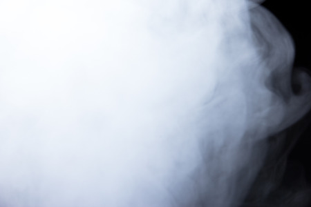 Abstract powder or smoke isolated on black background,Out of focus