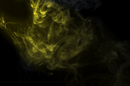 Abstract  golden powder or smoke isolated on black background