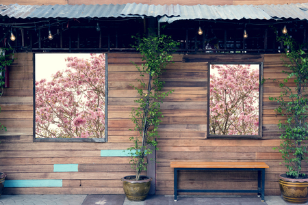 wooden bench with wall and window wood background
