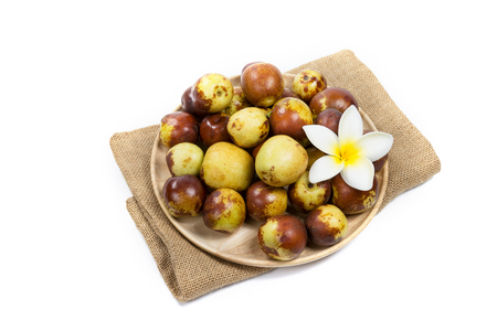 Chinese jujube on wood plate, isolated on white background