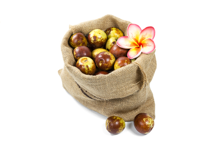 Chinese jujube in sack isolated on white background