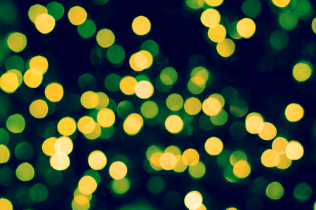 Colorful  Yellow  green  bokeh background of Christmas lights and New year,Vintage tone Stock Photo