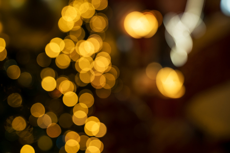 Colorful orange bokeh background of Christmas lights and New year Stock Photo