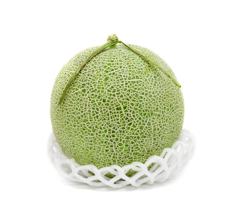 green cantaloupe melon with shockproof isolated on white background