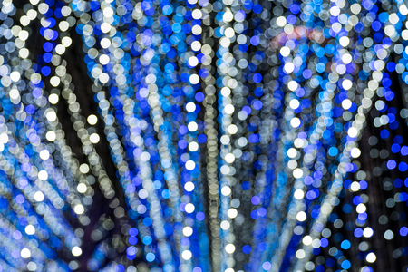 White blue bokeh lights of Christmas lights and New year
