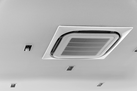 Air conditioner on ceiling in meeting room